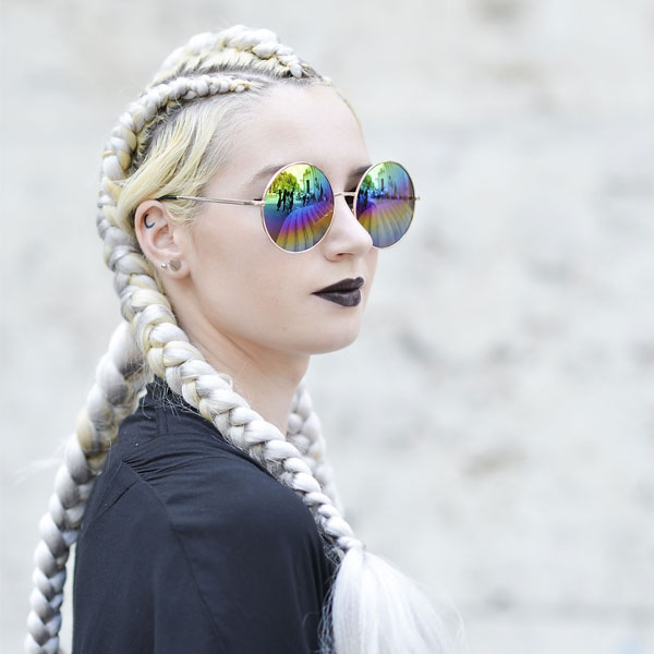 woman bleached blonde braids hairstyle hair trend 600 x 600