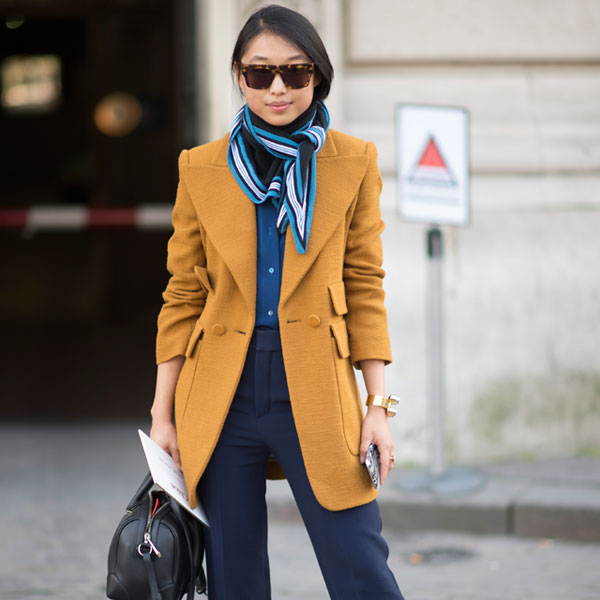 top fashion capitals featuring paris fashion week parisian street fashion wearing mustard yellow coat and scarf 600 x 600