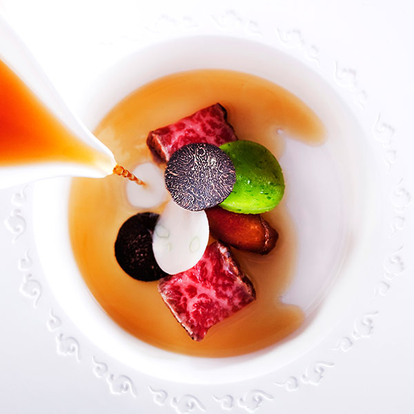 michelin star macau featuring chef alvin leung serving saga wagyu beef with black truffle