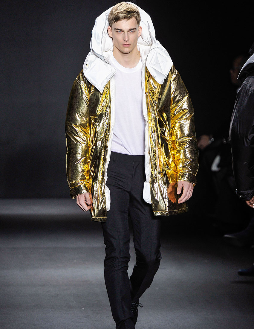 daring men's fashion trends featuring gold metallic coat