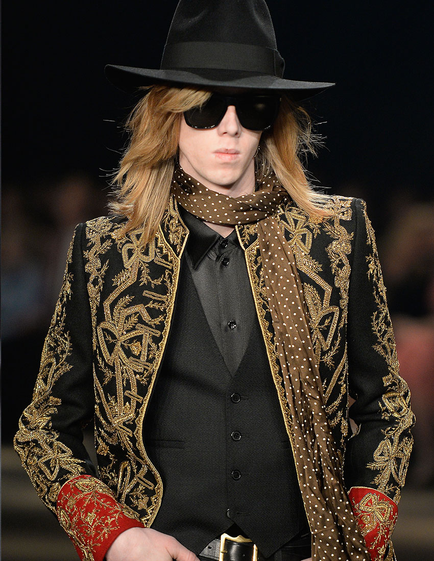 daring men's fashion trends featuring gold embroidered jacket